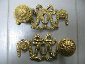 Ornate cast brass Roccoco-style handles with lock plates