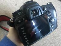 DSLR Nikon D7000 with nikor 55-200mm