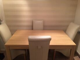 dining table (oak) and cream leather skirt chairs