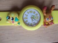 Moshi Monsters Watch. Yellow Rubber. Stud fastening. Katsuma and Mr Snoodles