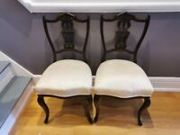 Pair of padded dining chairs