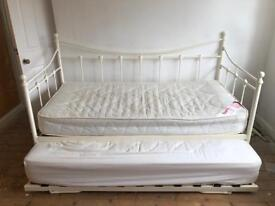 Cream metal day bed with trundle