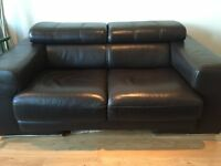 Two dark brown matching Italian VIOLINO sofas- with matching coffee and side tables.