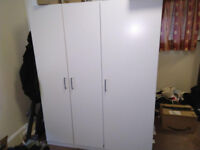 Three door wardrobe with hooks on the side