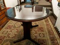 Extendable Dark Wood Round Dining Table