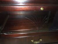 housing units of Hollinwood mahogany TV stand with DVD storage drawer