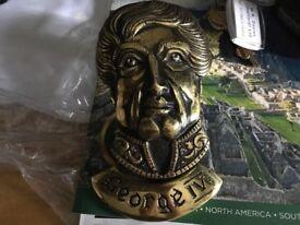 "Solid brass door knocker of George Xl approx. 6"" long. £10"