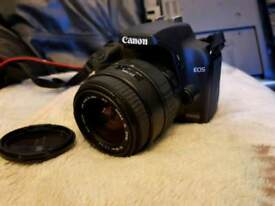 Canon Digital SLR camera 1000D with zoom lens