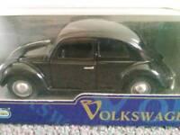 Black Collectible Volkswagen Beetle Scale Model.
