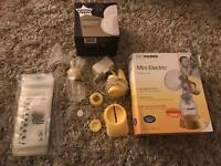 Medela mini electric breast pump and extras