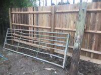 Farm field yard metal gate with post
