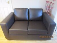2 BROWN 2 SEATER VINYL COUCHES/SOFAS brand new still wrapped COLLECTION ONLY! NOT FREE!!!1