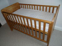John Lewis solid wood cotbed, suitable from birth to 6 years plus wooden bedguard.