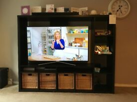 Black/brown tv unit. sturdy, minor mark see image. All wicker baskets included.