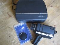 Old photographic accessories including movie camera and manual slide projectors