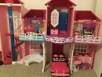 Barbies , Barbie house ,horse and carriage.