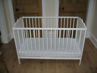 IKEA cot with its matching mattress
