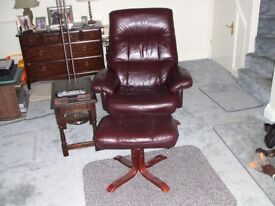 Leather reclining armchair with footstool.