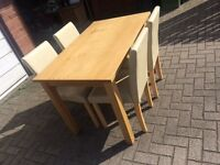 Wooden table with 4 faux leather chairs