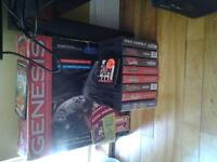 boxed genesis and games.