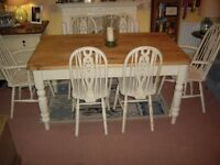 SOLID PINE TABLE AND SIX WHEEL BACK CHAIRS