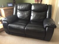 Black leather two seater electrically reclining sofa (2 for sale)
