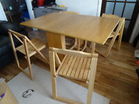 drop leaf table with 4 matching folding chairs