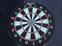 Dart board comes with Harrow Dart set