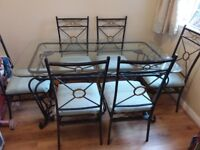 Lovely glass and wrought iron table with 6 chairs
