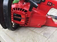 Petrol chain saw with new chain blade
