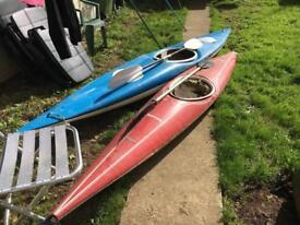 Two fibreglass kayaks