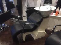 Salon chair and basins