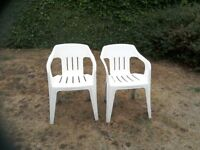 White plastic garden chairs