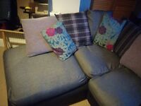 Black, grey and purple corner sofa
