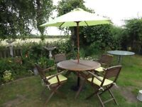 SOLID TEAK GARDEN SET --TABLE AND 4 CARVER CHAIRS --CUSHIONS --PARASOL + BASE --