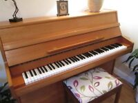 Modern upright piano in teak (1970's) owned from new, very little wear and very good condition.