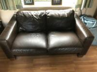 Two seater and three seater real leather sofas