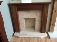 Solid timber and marble fire place