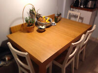 Great quality extendable dining table with four chairs