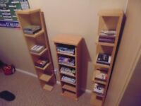 2 x Solid beech cd storage towers and 1 x solid beech dvd storage tower