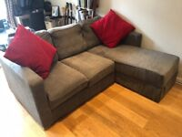Nabru sofa sofabed grey with chaise and storage (and red cushions)