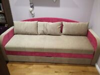 Sofa bed with storage and three pillows; very good condition