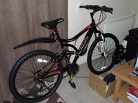 """Muddy Fox Chaos 18 speed mountain bike 18"""" frame 26"""" wheels front and back suspension. Never used."""