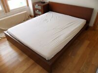 Ikea bed with 2m long mattress appx 211 cms long x 178 wide.