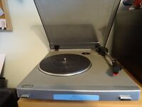 Bush turntable, with on'off switch. No amp or speakers.