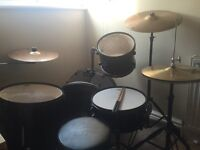 5 Piece drum kit with cymbals and practice pads