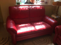 Free 3 and 2 piece red leather sofa and foot rest