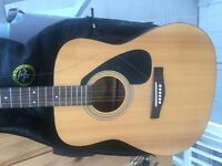 Yamaha acoustic guitar for sale, good condition with cover.
