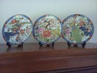 Six collector display plates.