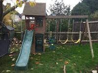 Children's play house and swings
